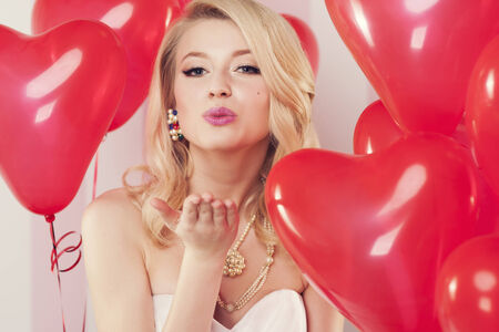 Valentines girl blowing sweet kisses photo