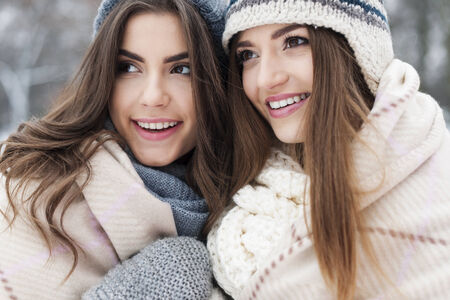 Close up of female friends during the winter  photo