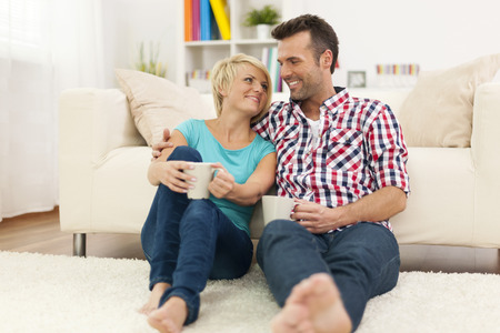Loving couple relaxing at home with cup of coffee Stock Photo - 25697327