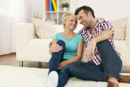 Couple in love relaxing in living room Stock Photo - 25697343