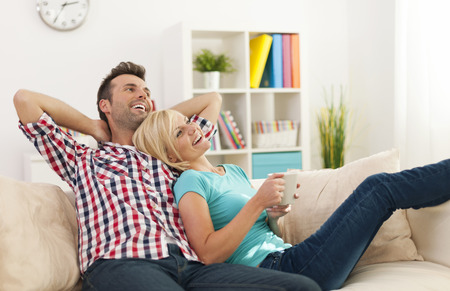 Happy couple relaxing together at home Stock Photo - 25697236