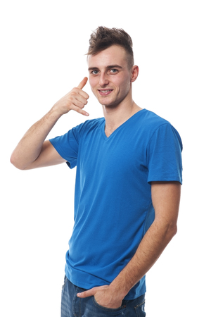 Young man making call me gesture photo