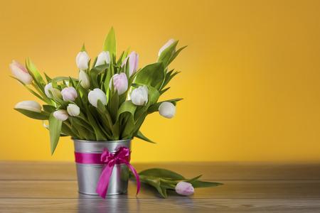 tulips in vase: Bright tulips in decorative pot