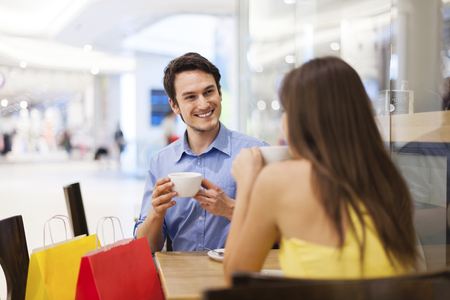 Meeting in cafe after shopping   photo