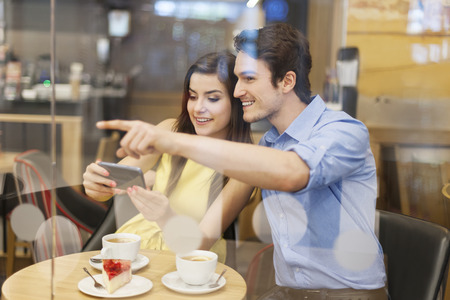 Man showing his girlfriend searched place