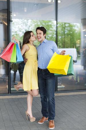 grateful: Grateful woman thanking her boyfriend for successful shopping
