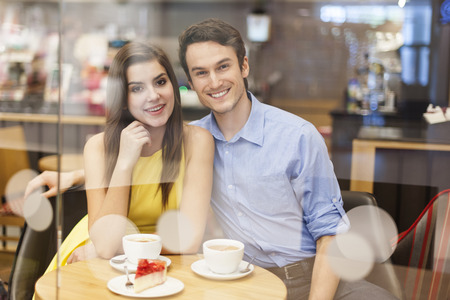 Portrait of beautiful couple in cafe  photo