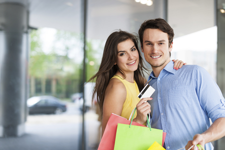 loves: Portrait of couple which loves shopping