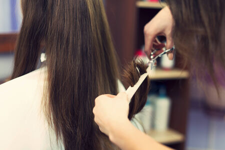 cutting hair: Close up of long hair cut by hairdresser Stock Photo