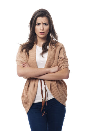 Stressed young woman with arms crossed photo