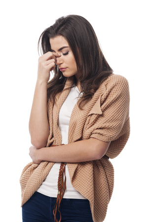 sinusitis: Worried young woman with sinusitis Stock Photo
