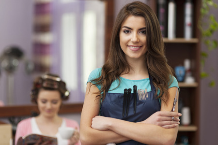 Portrait of smiling owner of hairdresser salon Stock Photo