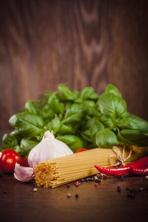 Raw products on italian spaghetti photo