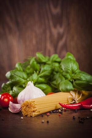 Raw products on italian spaghetti photo
