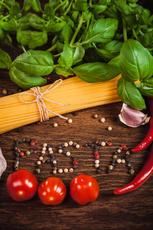 Close up of ingredient on italian meal and text PASTA from grained pepper   photo