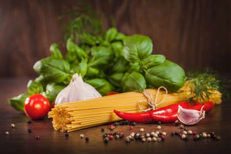 Products on spaghetti bolognese on wood  photo