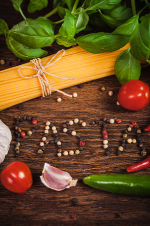 Frame from ingredients on spaghetti with text PASTA from grained pepper   photo