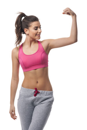 hand bra: Young woman checking herself muscles