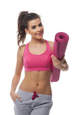 happy healthy woman: Happy healthy woman with yoga mat  Stock Photo