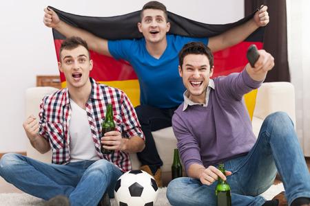 Excitement men cheering football match photo