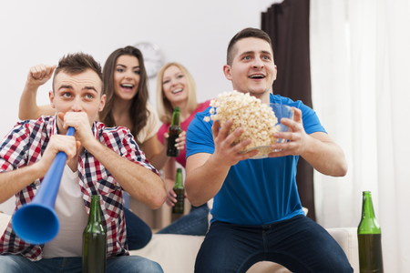group goals: Young group of people celebrating win of favourite sports team  Stock Photo
