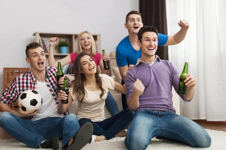 Group of friends enjoying soccer in TV Stock Photo - 26603457