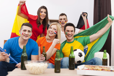 multi national: Group of multi national football fans cheering  Stock Photo