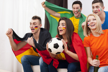 Young soccer fans during the watching match on TV  photo
