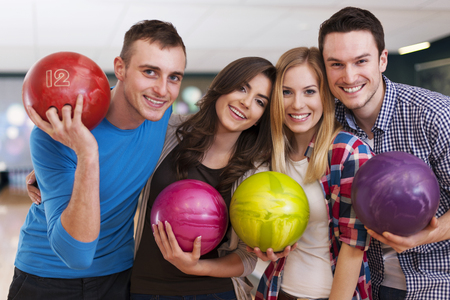 Young friends at the bowling alley photo