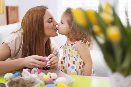 multi family house: Loving mother and baby in easter time