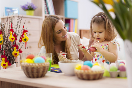 creative egg painting: Mother and baby painting easter eggs