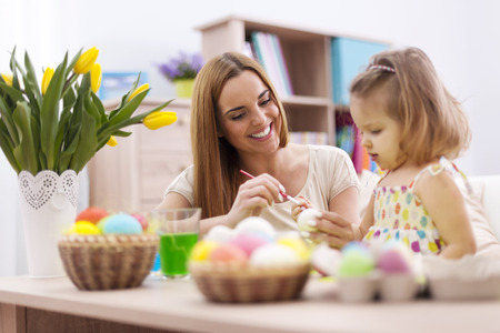 Loving family in easter holiday painting eggs  photo