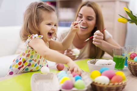 painting and decorating: Happy time while painting easter eggs   Stock Photo