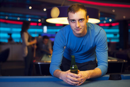 Portrait of handsome man in billiard club photo