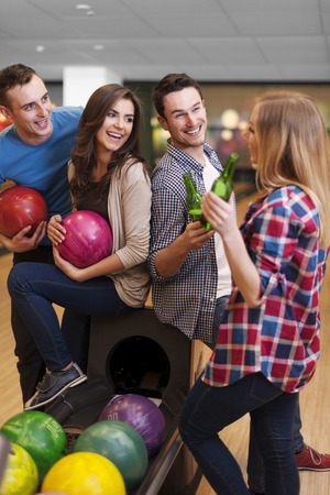 beer bottle: Happy time at the bowling alley