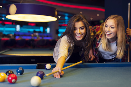 bending over: Two female friends enjoying pool game