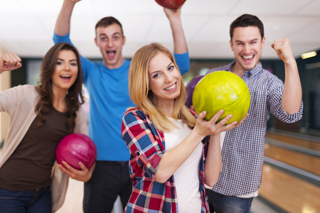 Group of young friend at the bowling alley photo