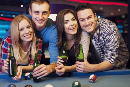 Party with friends in nightclub with billiards photo