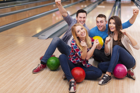bowling pin: Young group of friends in bowling alley