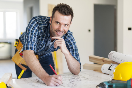 Portrait of construction worker with plans  photo