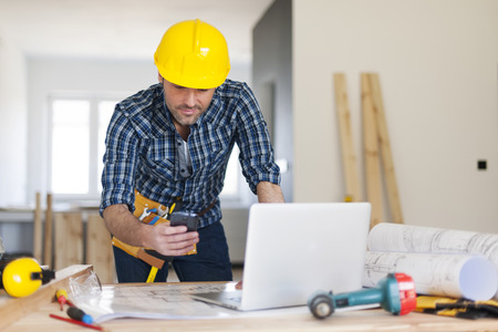 Busy building contractor at work  photo