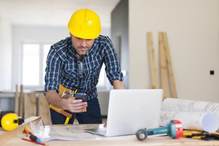 Busy building contractor at work Banco de Imagens - 27039880