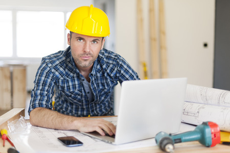 Manly construction worker at work  photo