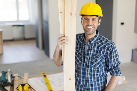building worker: Portrait of happy and handsome carpenter Stock Photo