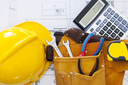 construction work: Work tools with helmet and calculator on home plans