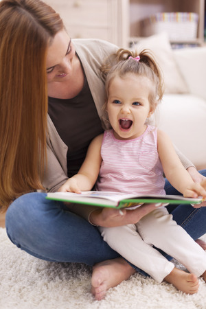 Huge joy from listen like mother reading book photo