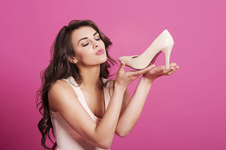 sex symbol: Addicted from high heels woman kissing her new shoes