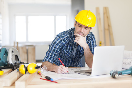 residential construction: Focus construction worker on construction site Stock Photo