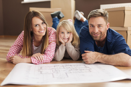 home planning: Happy family planning their new apartment