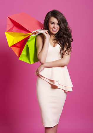 Elegant and smiling woman with shopping bags  photo